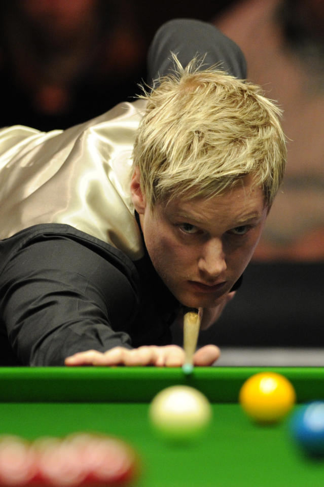 Neil Robertson of Australia plays a shot against Judd Trump of England during the semi-final match in the BGC Masters snooker tournament at Alexandra Palace in north London on January 21, 2012. Robertson went on to win the match 6-3. AFP PHOTO / CARL COURT (Photo credit should read CARL COURT/AFP/Getty Images)