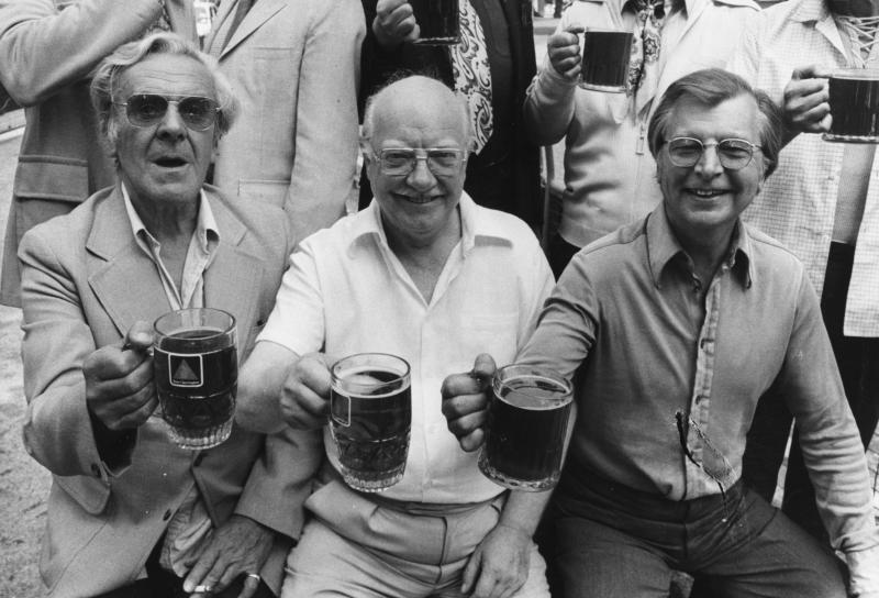 Actors from the television show 'Dad's Army', (L-R) John Le Mesurier, Arthur Lowe and Clive Dunn, holding their pints of being aloft as they celebrate the West End stage production of their show, August 26th 1975. (Photo by Frank Barratt/Keystone/Getty Images)