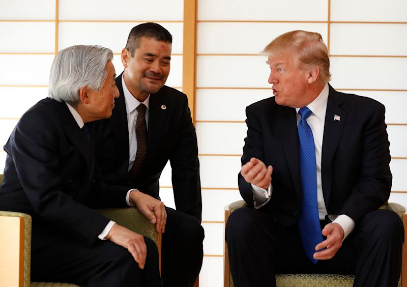 U.S. President Donald Trump, right, talks with Japan's Emperor Akihito, left, at the Imperial Palace in Tokyo, Japan Monday, Nov. 6, 2017. (Issei Kato/Pool Photo via AP)