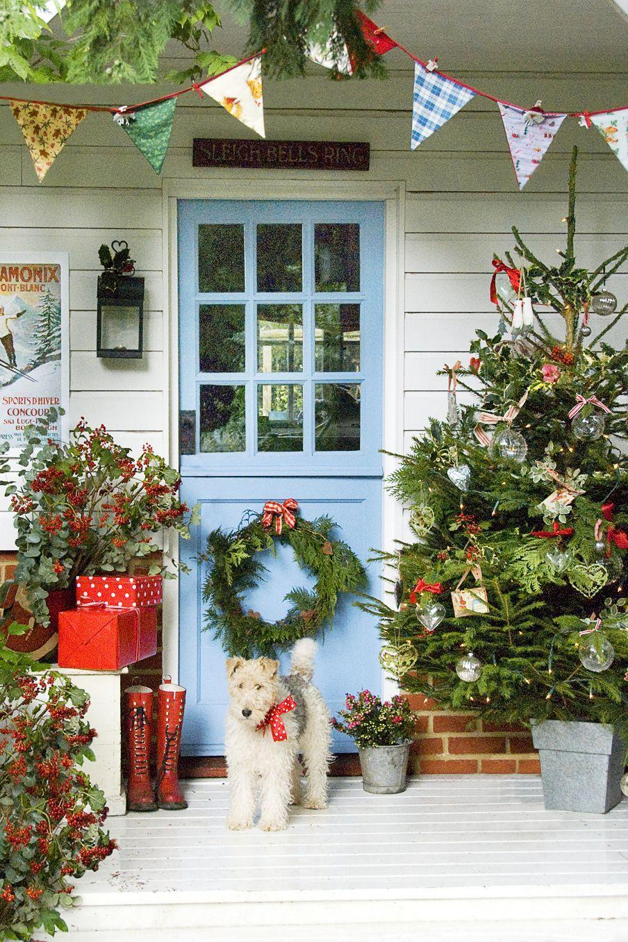 "<p>It's all about placement: Hang a wreath down low, so that guests can still get a peek at the Christmas tree glimmering inside. </p><p><strong>RELATED:</strong> <a href=""https://www.goodhousekeeping.com/holidays/christmas-ideas/g2966/christmas-decoration-hanging-hacks/"" rel=""nofollow noopener"" target=""_blank"" data-ylk=""slk:Tricks to Make Hanging Christmas Decorations Way Easier"" class=""link rapid-noclick-resp"">Tricks to Make Hanging Christmas Decorations Way Easier</a></p>"