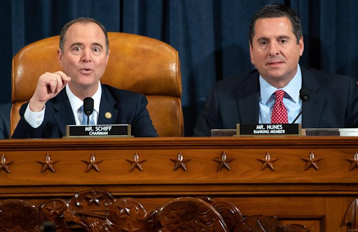 Chairman Adam Schiff (L), Democrat of California, and Ranking Member Devin Nunes (R), Republican of California, during the first public hearings held by the House Permanent Select Committee on Intelligence as part of the impeachment inquiry into US President Donald Trump, Nov. 13, 2019.