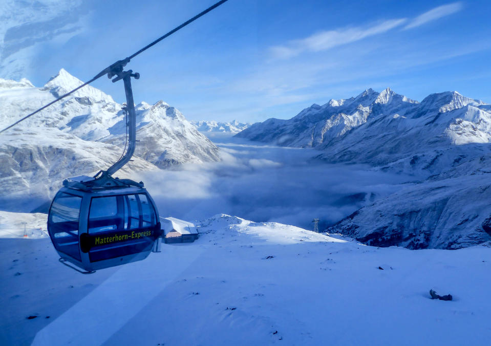 An empty gondola goes up in Zermatt, Switzerland, Thursday, Dec.3, 2020. Zermatt is home to one of the Swiss ski stations that has become an epicenter of discord among Alpine neighbors. EU member states Austria, France, Germany and Italy are shutting or severely restricting access to the slopes this holiday season amid COVID-19 concerns, Switzerland is not. (AP Photo/Jamey Keaten)