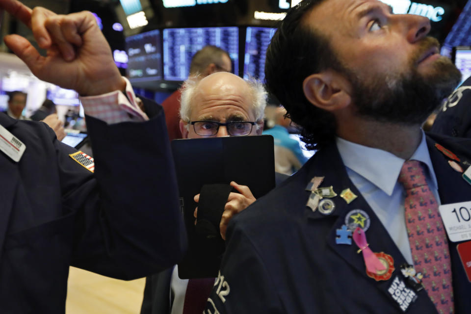 Trader Peter Tuchman, center, works on the floor of the New York Stock Exchange. (Photo: AP Photo/Richard Drew, File)