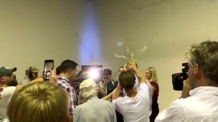 Australian Senator Fraser Anning has an egg smashed on his head while talking to the media in Victoria, Australia March 16, 2019 in this still image taken from a video obtained from social media. THE UNSHACKLED/via REUTERS