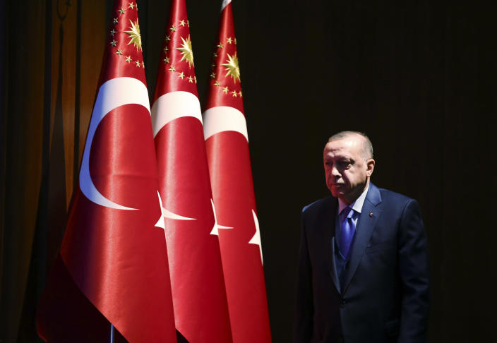 Turkey's President Recep Tayyip Erdogan arrives to deliver a speech at an event in Ankara, Turkey, Monday, Dec. 30, 2019. Turkey's government on Monday submitted a motion to parliament seeking approval to deploy troops to Libya, to help authorities in Tripoli defend the city from an offensive by rival forces, arguing that the conflict in the North African country could escalate into a civil war and threaten Turkey's interests. (Presidential Press Service via AP, Pool)