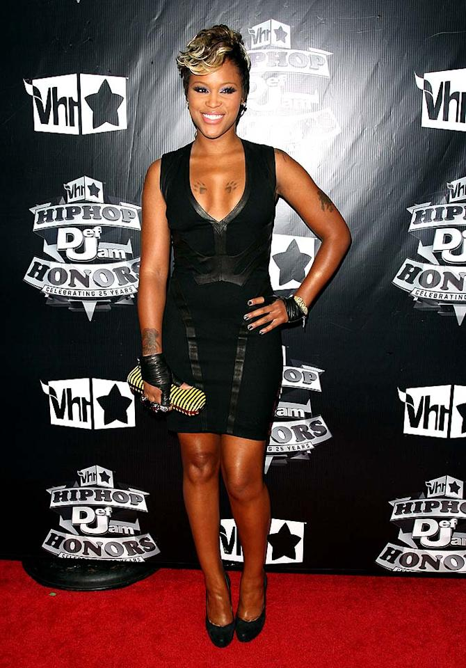 "Eve looked cute in a lil' black dress, but what do you think about her cutaway gloves and bee-striped clutch? Jason Kempin/<a href=""http://www.filmmagic.com/"" target=""new"">FilmMagic.com</a> - September 23, 2009"