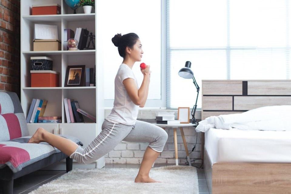 Asian women exercising in bed in the morning