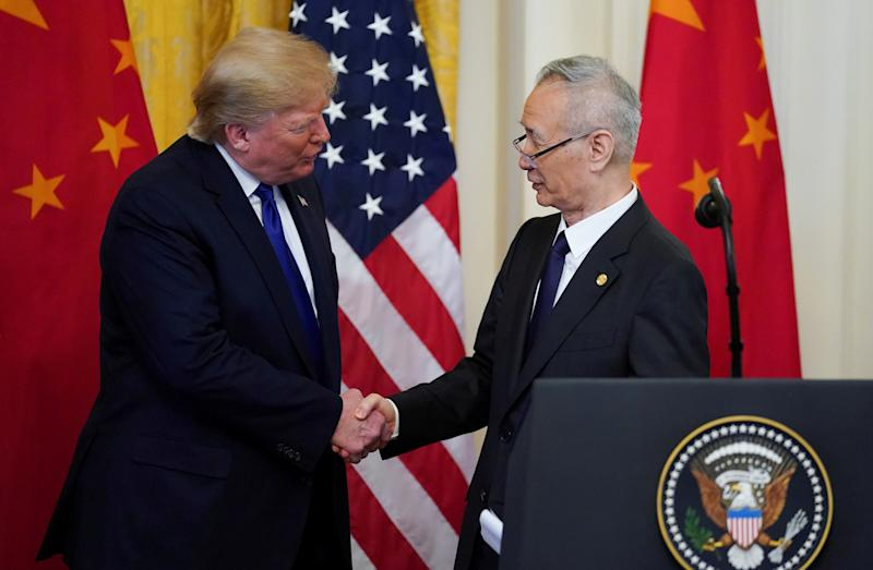 "U.S. President Donald Trump shakes hands with Chinese Vice Premier Liu He during a signing ceremony for ""phase one"" of the U.S.-China trade agreement in the East Room of the White House in Washington, U.S., January 15, 2020. REUTERS/Kevin Lamarque"