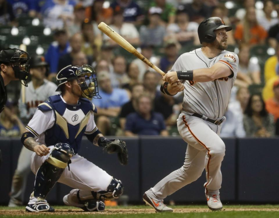 San Francisco Giants' Stephen Vogt gets a hit during the ninth inning of a baseball game against the Milwaukee Brewers Saturday, July 13, 2019, in Milwaukee. Two runs scored on the play. (AP Photo/Morry Gash)