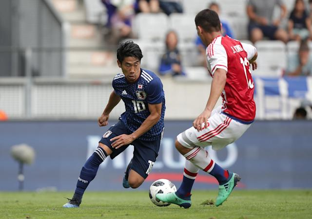 Soccer Football - International Friendly - Japan vs Paraguay - Tivoli-Neu, Innsbruck, Austria - June 12, 2018 Japan's Shinji Kagawa in action with Paraguay's Junior Alonso REUTERS/Lisi Niesner