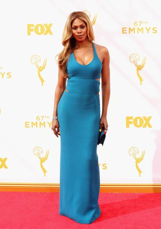"""<p>Not only did Laverne Cox refuse to be cut off by Ryan Seacrest before giving credit to Calvin Klein for her dress, she also made sure to specifically name Francisco Costa as the man behind it. The """"Orange Is the New Black"""" actress wore a green dress and then added some mint heels for contrast.<br></p>"""