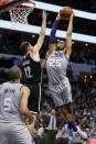 Charlotte Hornets' P.J. Washington (25) goes over Brooklyn Nets' Joe Harris (12) for a dunk during the second half of an NBA basketball game in Charlotte, N.C., Friday, Dec. 6, 2019. The Nets won 111-104. (AP Photo/Bob Leverone)