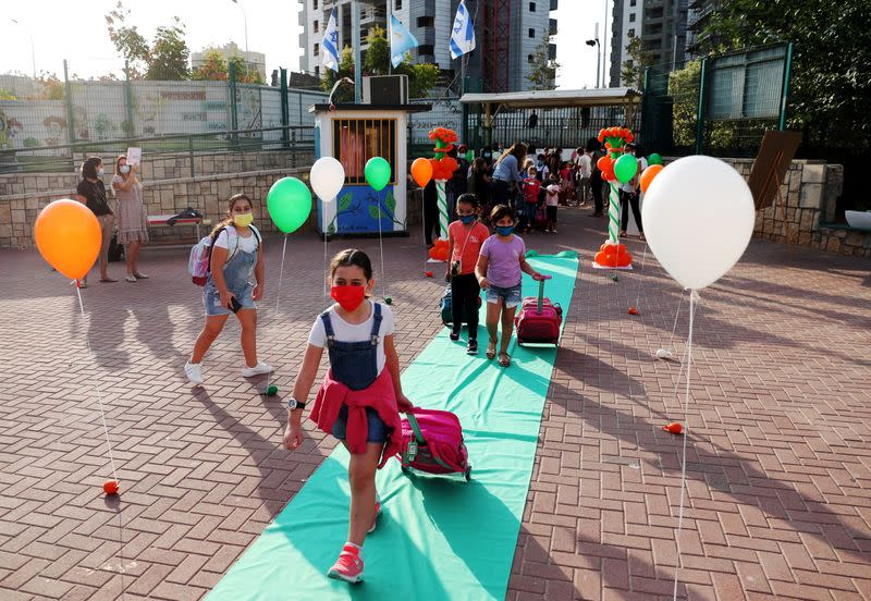 Pupils, wearing protective face masks, arrive at their school as Israel reopens first to fourth grades, continuing to ease a second nationwide coronavirus disease (COVID-19) lockdown, at a school in Rehovot
