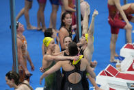 The team from Australia celebrates after winning the final of the women's 4x100m freestyle relay at the 2020 Summer Olympics, Sunday, July 25, 2021, in Tokyo, Japan. (AP Photo/Petr David Josek)
