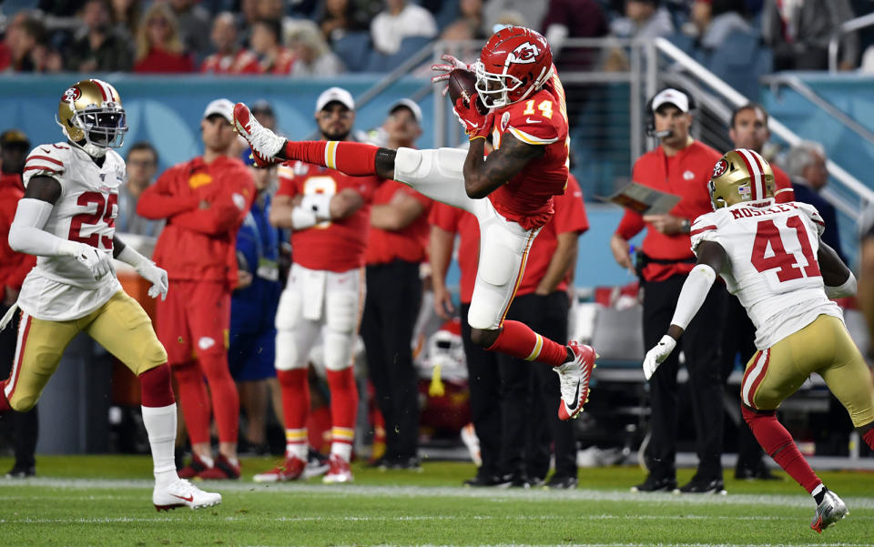 Kansas City Chiefs wide receiver Sammy Watkins (14) catches a pass between San Francisco 49ers defensive back Emmanuel Moseley (41) and strong safety Jaquiski Tartt (29) in the first half of Super Bowl 54 on Feb. 2, 20202 at Hard Rock Stadium in Miami Gardens, FL. (Tammy Ljungblad/Kansas City Star/Tribune News Service via Getty Images)