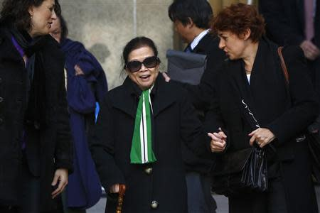 Vilma Bautista (C), the ex-secretary of former Philippine first lady Imelda Marcos, smiles after her sentencing at the Manhattan Supreme Court in New York, January 13, 2014. Bautista was sentenced in the New York court after she was found guilty of conspiracy in the attempted sale of a Monet painting and other valuable artworks. REUTERS/Shannon Stapleton