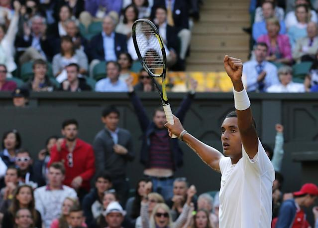 Nick Kyrgios of Australia celebrates after winning the third set against Rafael Nadal of Spain during their men's singles match on Centre Court at the All England Lawn Tennis Championships in Wimbledon, London, Tuesday, July 1, 2014. (AP Photo/Ben Curtis)