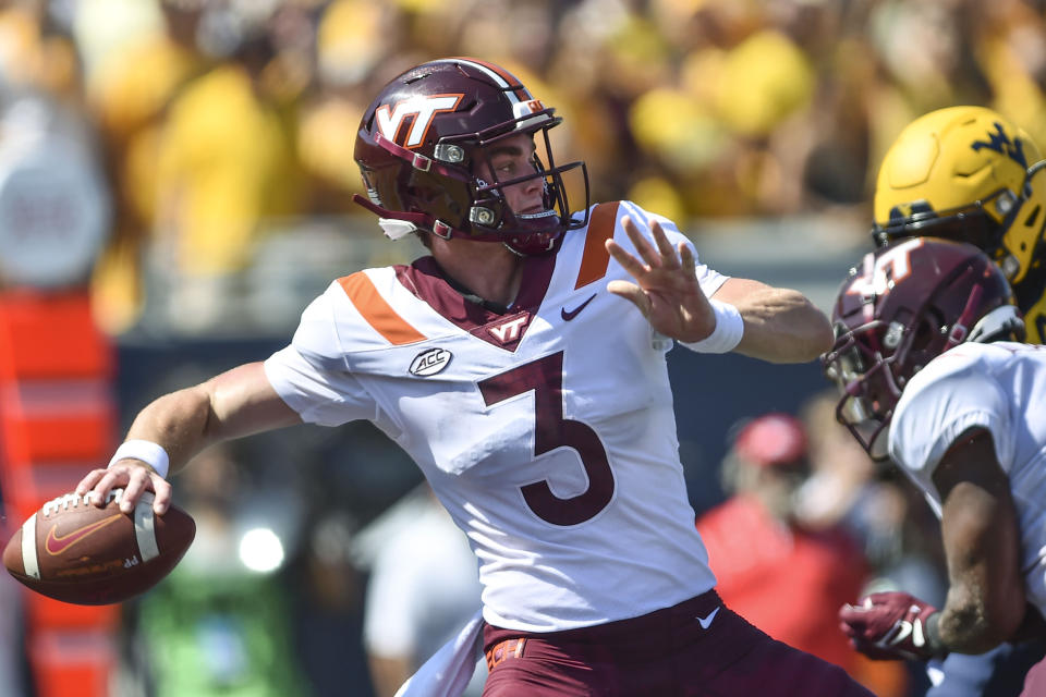 Virginia Tech quarterback Braxton Burmeister (3) makes a pass against West Virginia during the first half of an NCAA college football game in Morgantown, W.Va., Saturday, Sept. 18, 2021. (AP Photo/William Wotring)