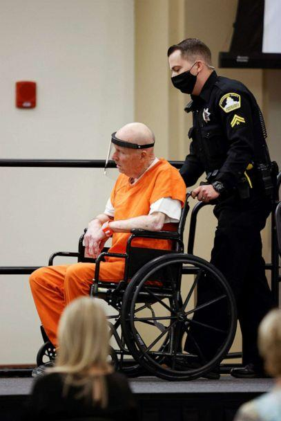 PHOTO: A police officer pushes the wheelchair of Joseph James DeAngelo Jr. as he arrives at the Sacramento County courtroom for a hearing on crimes attributed to the Golden State Killer, in Sacramento, Calif., June 29, 2020. (Fred Greaves/Reuters)