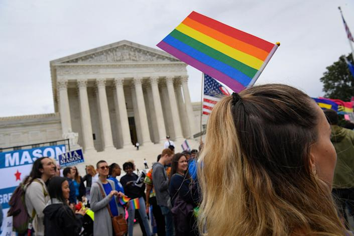 Demonstrators gather in front of the Supreme Court in October 2019 as the justices hear challenges involving workers who claimed they were fired for being gay or transgender.