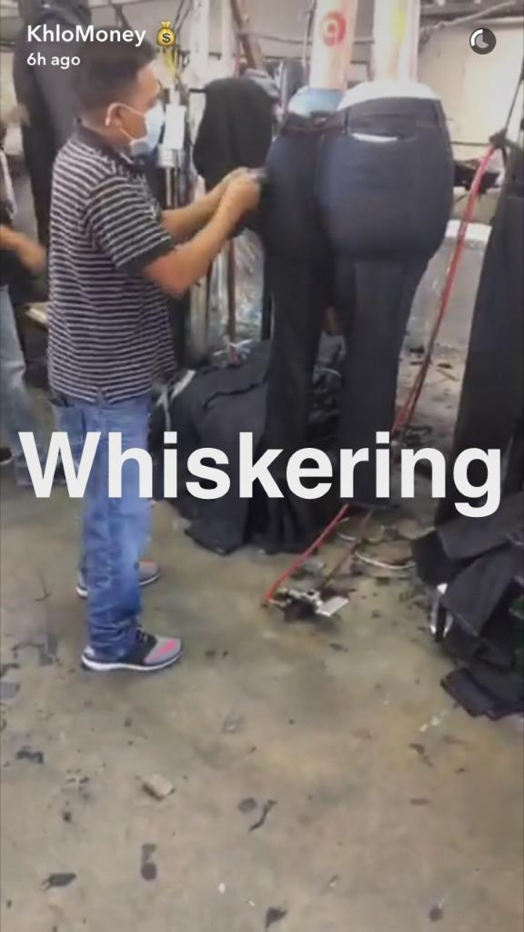 Kardashian films hand-detailing of her product by skilled factory workers. (Photo: Courtesy of Snapchat/KhloMoney)