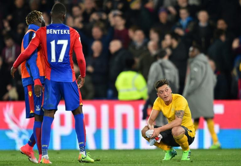 Arsenal midfielder Mesut Ozil (R) contemplates his side's 3-0 defeat in their Premier League match against Crystal Palace at Selhurst Park in south London on April 10, 2017