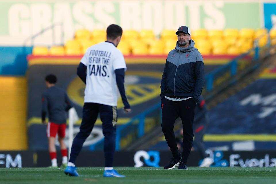 Jurgen Klopp watches on as Leeds players wear t-shirts in protest against the European Super LeagueGetty
