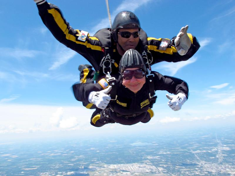 In this Saturday, June 23, 2012, photo provided by Sgt. 1st Class Marc Owens, 83-year-old Marjorie Bryan makes a tandem jump with retired Sgt. 1st Class Michael Elliott at the Allen County Airport in Lima, Ohio. Bryan and 82-year-old Marianna Sherman parachuted from a plane to raise money for the local chapter of Blue Star Mothers of America and its veterans' food pantry. Blue Star members are mothers whose children have served in the military. (AP Photo/Courtesy Sgt. 1st Class Marc Owens)