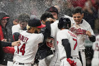 Cleveland Indians' Oscar Mercado, center, is mobbed by teammates after hitting a two-run home run in the seventh inning in the second baseball game of a doubleheader against the Chicago White Sox, Thursday, Sept. 23, 2021, in Cleveland. The Indians won 5-3. (AP Photo/Tony Dejak)