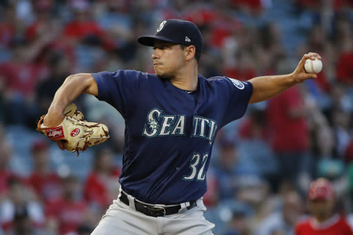 Seattle Mariners starting pitcher Marco Gonzales throws to a Los Angeles Angels batter during the first inning of a baseball game Wednesday, July 11, 2018, in Anaheim, Calif. (AP Photo/Jae C. Hong)
