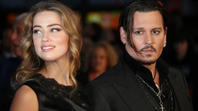 Johnny Depp dan Amber Heard (AP Photo)