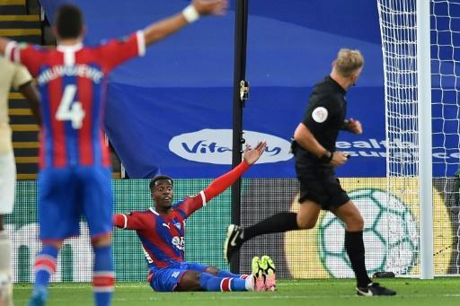 VAR denied Palace a penalty when Wilfried Zaha (centre) went down