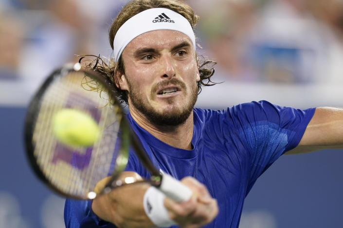 FILE - Stefanos Tsitsipas, of Greece, hits a forehand to Alexander Zverev, of Germany, during the Western & Southern Open tennis tournament in Mason, Ohio, in this Saturday, Aug. 21, 2021, file photo. Tsitsipas is seeded for the U.S. Open, the year's last Grand Slam tennis tournament. Play in the main draw begins in New York on Monday, Aug. 30. (AP Photo/Darron Cummings, FIle)