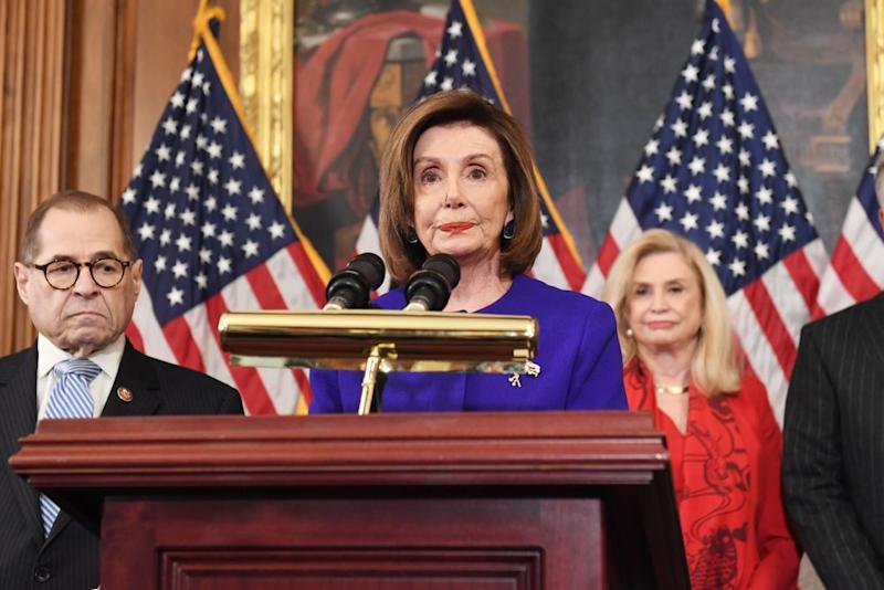 House Speaker Nancy Pelosi and leaders from House investigative committees on Tuesday | Saul Loeb/AFP/Getty
