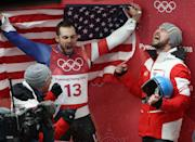 <p>David Gleirscher of Austria is congratulated by a teammates after winning gold while Chris Mazdzer of the United States celebrates in the background after he won silver in the Luge Men's Singles on day two of the PyeongChang 2018 Winter Olympic Games at Olympic Sliding Centre on February 11, 2018 in Pyeongchang-gun, South Korea. (Photo by Ezra Shaw/Getty Images) </p>
