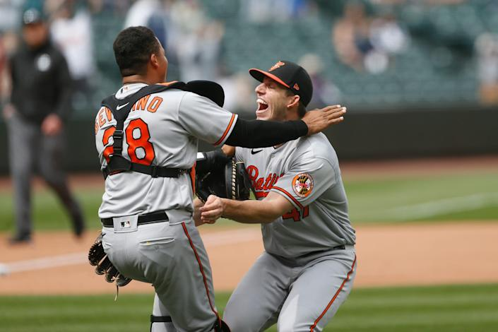 Orioles starting pitcher John Means and catcher Pedro Severino celebrate following the final out of Means' no-hitter against the Mariners.