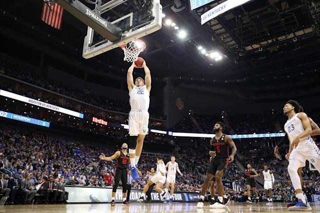 <p>Reid Travis #22 of the Kentucky Wildcats dunks the ball against the Houston Cougars during the 2019 NCAA Basketball Tournament Midwest Regional at Sprint Center on March 29, 2019 in Kansas City, Missouri. (Photo by Christian Petersen/Getty Images) </p>