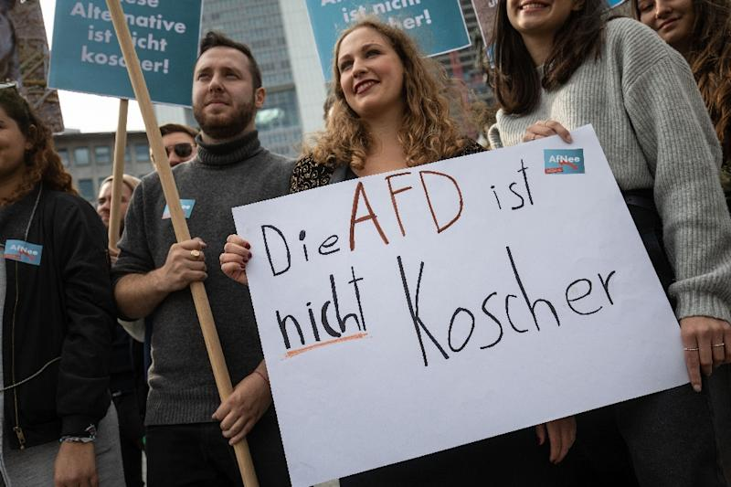 "Some 250 people, many from Jewish organisations, protested in Frankfurt against the new group with banners reading ""The AfD is not kosher"" (AFP Photo/Frank Rumpenhorst)"