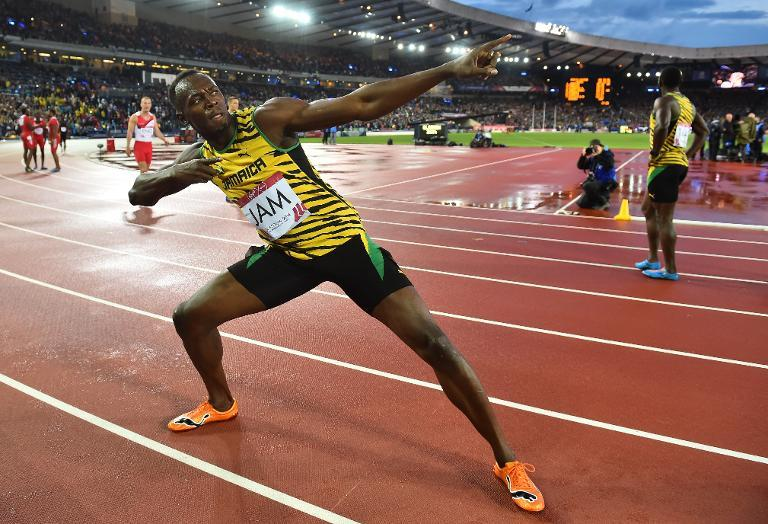 Jamaica's Usain Bolt poses after winning the men's 4 x 100m relay athletics event at Hampden Park during the 2014 Commonwealth Games in Glasgow, Scotland on August 2, 2014 (AFP Photo/Ben Stansall )