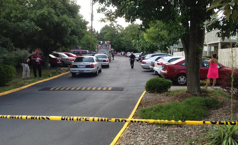 Police tape ropes off area at Lakeview Condominiums, where three people were shot to death and a fourth was seriously injured at a condominium building Wednesday, June 19, 2013 in Louisville, Ky. (AP Photo/The Courier-Journal, Michael Dossett) NO SALES; MAGS OUT; NO ARCHIVE; MANDATORY CREDIT