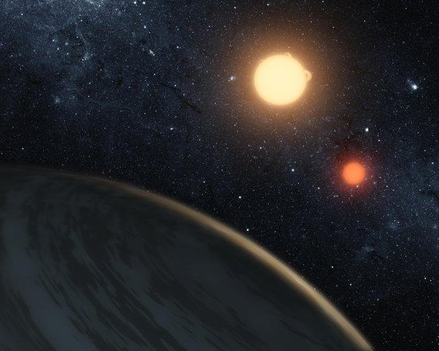 NASA handout image shows an artist's concept of the circumbinary planet Kepler-16b - the first planet known to definitively orbit two stars. The cold planet, with its gaseous surface, is not thought to be habitable. The largest of the two stars, a K dwarf, is about 69 percent the mass of our sun, and the smallest, a red dwarf, is about 20 percent the sun's mass. These star pairs are called eclipsing binaries. REUTERS/NASA/JPL-Caltech/T. Pyle/Handout