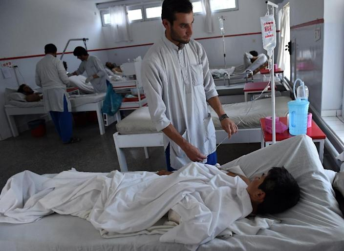 An Afghan boy, a survivor of the US airstrikes on a Doctors Without Borders Hospital in Kunduz, receives treatment at Emergency hospital, run by an Italian aid organization, in Kabul on October 6, 2015 (AFP Photo/Wakil Kohsar)