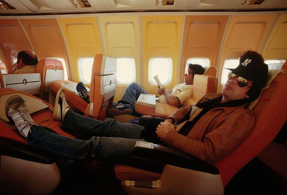<p>Billy Joel puts his feet up and catches some shut-eye on a plane in 1978.</p>