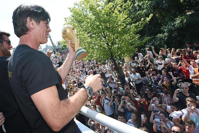 Germany's coach Joachim Loew celebrates during a victory parade of Germany's football national team on July 15, 2014 at Berlin's landmark Brandenburg Gate (AFP Photo/Markus Gilliar)