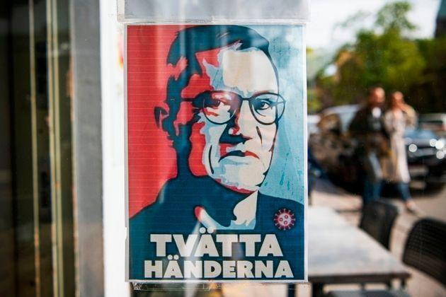 A sign with a portrait of Anders Tegnell, the face of the country's response to the novel coronavirus COVID-19 pandemic, is hanged at an entrance to a restaurant to instruct people to wash their hands on May 10.