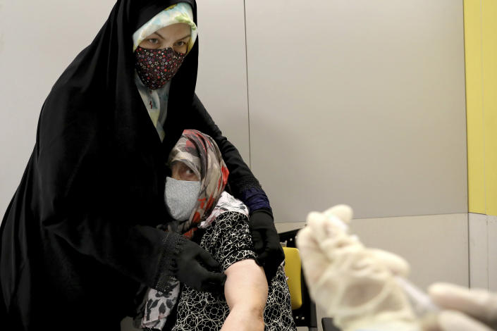 An Iranian woman receives a Sinopharm vaccine for COVID-19 at the Iran Mall shopping center, in Tehran, Iran, Monday, May 17, 2021. Last month Iran started vaccinating elderly people against the coronavirus. (AP Photo/Ebrahim Noroozi)