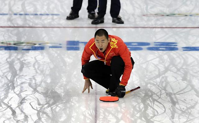 China's skip Liu Rui shouts instructions to his teammates during the men's curling bronze medal game against Sweden at the 2014 Winter Olympics, Friday, Feb. 21, 2014, in Sochi, Russia. (AP Photo/Wong Maye-E)