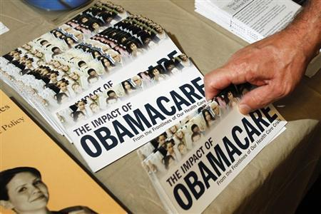 File photo of an Obamacare pamphlet at a Tea Party rally in Littleton