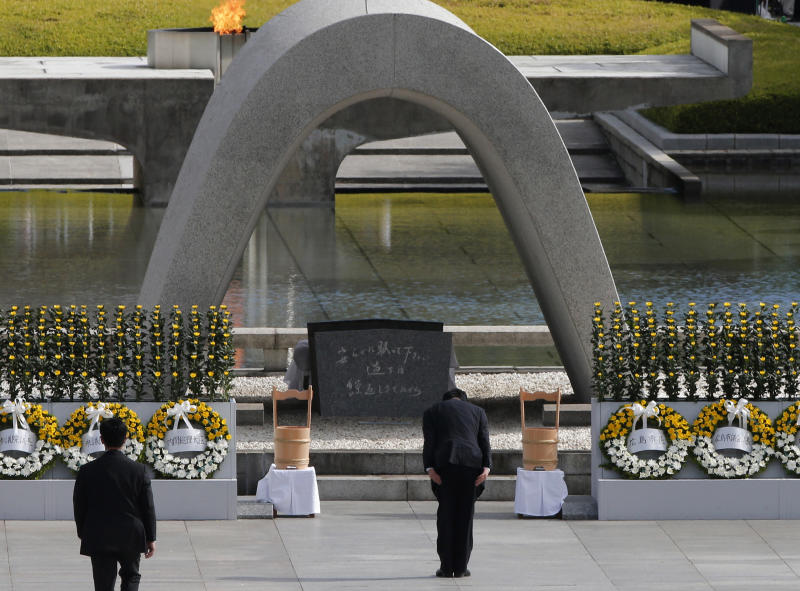 Japanese Prime Minister Yoshihiko Noda, right, bows in front of the cenotaph for the bombing victims during the ceremony marking the 67th anniversary of the atomic bombing at Hiroshima Peace Memorial Park in Hiroshima, western Japan, Monday, Aug. 6, 2012.(AP Photo/Itsuo Inouye)