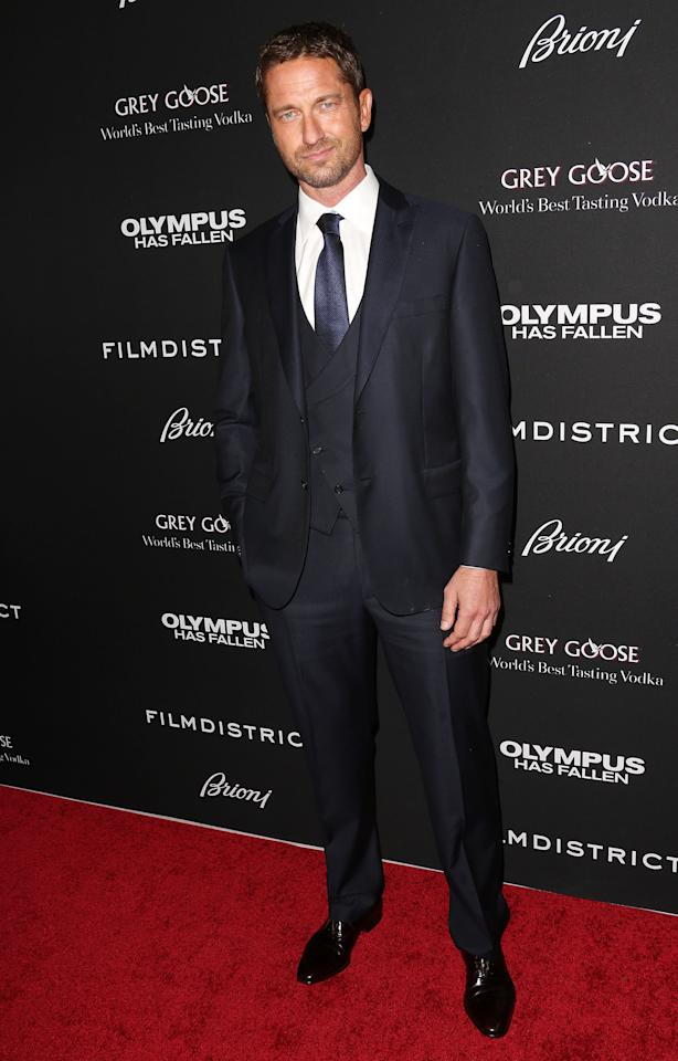 """HOLLYWOOD, CA - MARCH 18: Actor Gerard Butler attends the Premiere of FilmDistrict's """"Olympus Has Fallen"""" at the ArcLight Cinemas Cinerama Dome on March 18, 2013 in Hollywood, California.  (Photo by Frederick M. Brown/Getty Images)"""